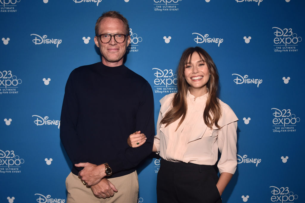 Paul Bettany and Elizabeth Olsen pose at the D23 Expo 2019.