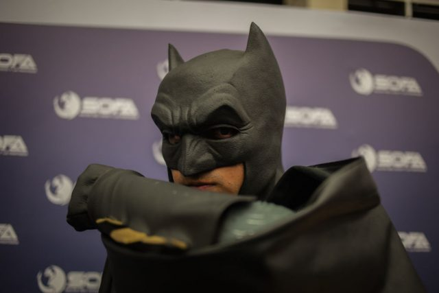 Batman cosplay poses for a photo