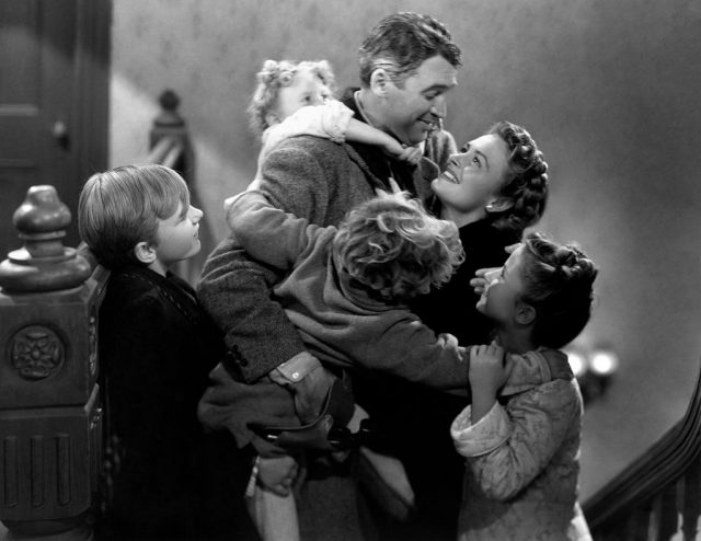 James Stewart, Donna Reed, Carol Coombs, Jimmy Hawkins, Larry Simms and Karolyn Grimes in 'It's A Wonderful Life'