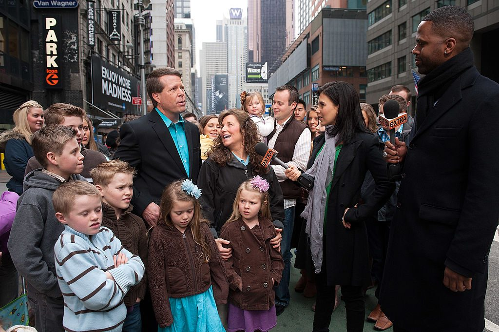 AJ Calloway and Hilaria Baldwin interview the Duggar family during their visit with 'Extra' in Times Square