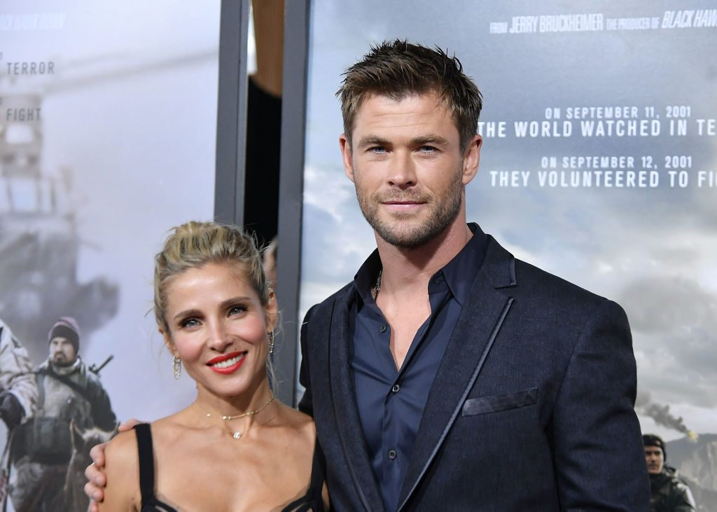 Elsa Pataky (L) and husband Chris Hemsworth (R) attend a movie premiere