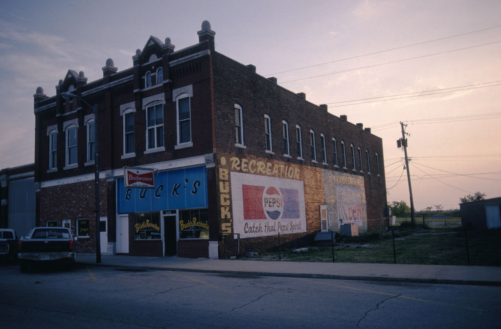 Pepsi and Budweiser signs outside Buck's Recreation in the city of Galena, Kansas, 1988.