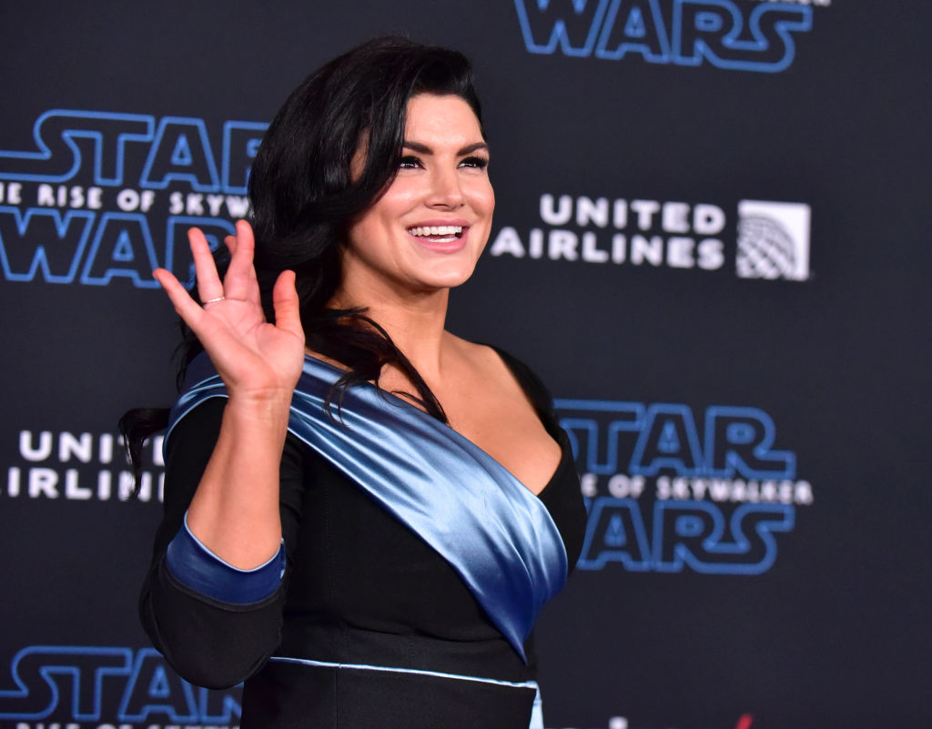 Gina Carano, who plays Cara Dune, waves at the red carpet for the premiere for 'Star Wars: The Rise Of Skywalker.'