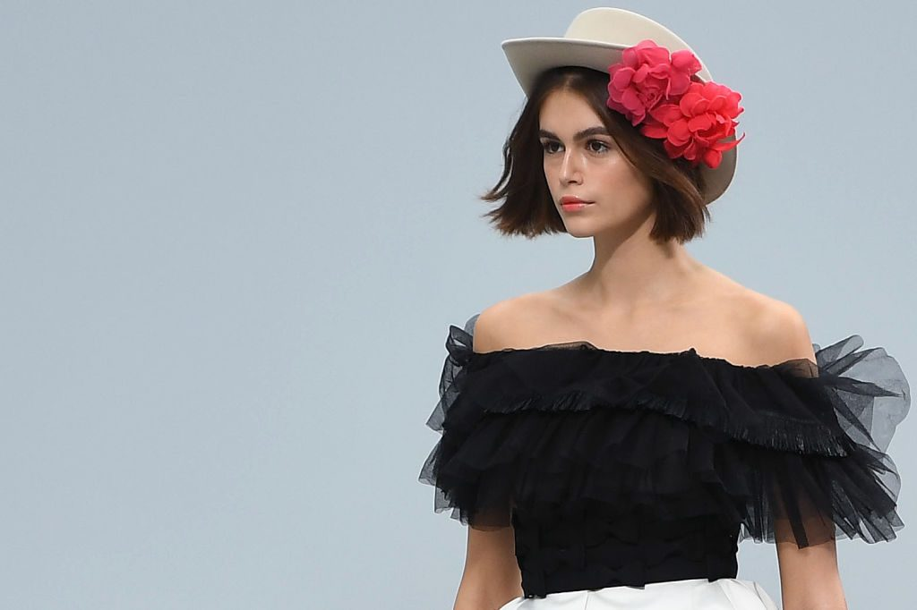 Kaia Gerber presents a creation by Chanel during the Women's Spring-Summer 2020 Ready-to-Wear collection fashion show
