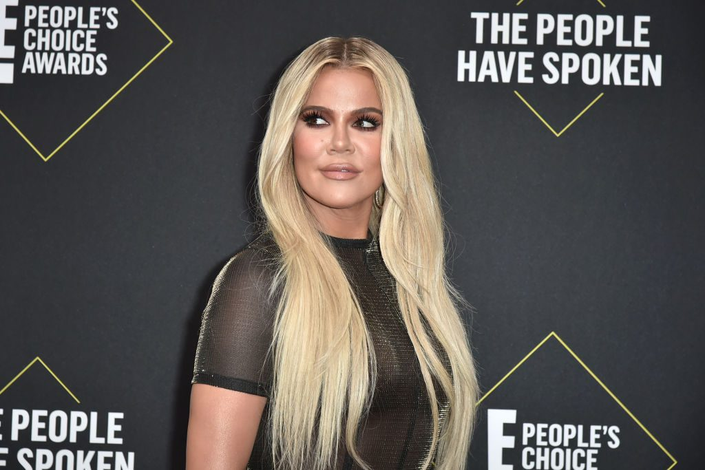 Khloe Kardashian poses for a photo at the People's Choice Awards red carpet