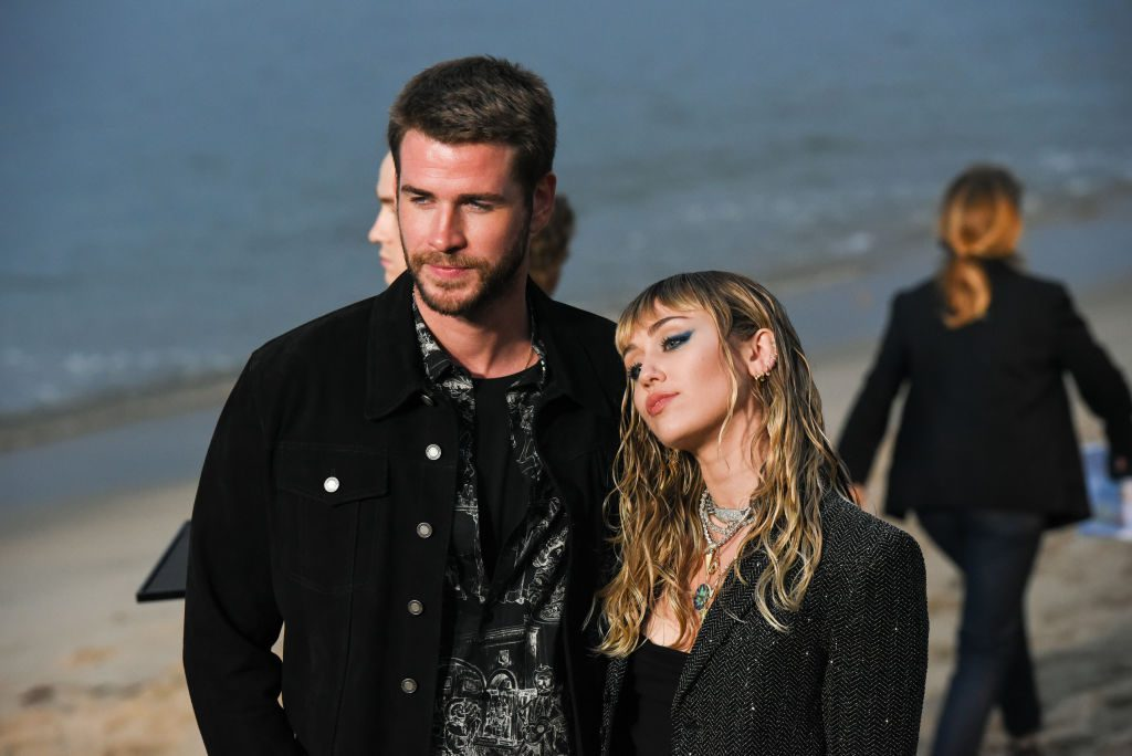 Liam Hemsworth and Miley Cyrus at Saint Laurent mens spring summer 20 show on June 06, 2019
