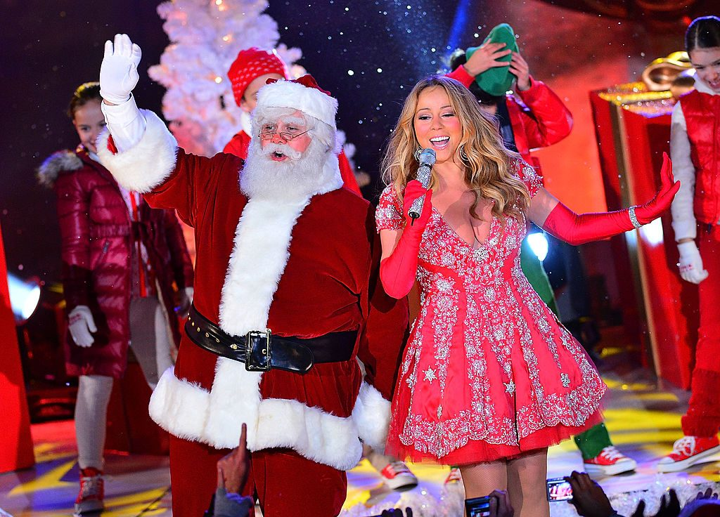 Santa Claus and Mariah Carey perform during a pre-tape performance for NBC's Christmas tree lighting at Rockefeller Center