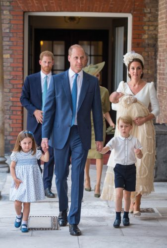 Prince William, Kate Middleton, and their children followed by Prince Harry and Meghan Markle on July 9, 2018, at the christening of Prince Louis