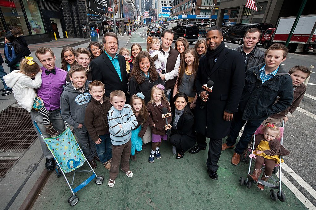 "AJ Calloway and Hilaria Baldwin pose with the Duggar family during their visit with ""Extra"" in Times Square on March 11, 2013 in New York Cit"