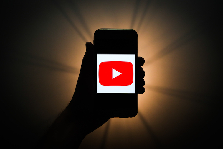 YouTube logo shown on a phone screen