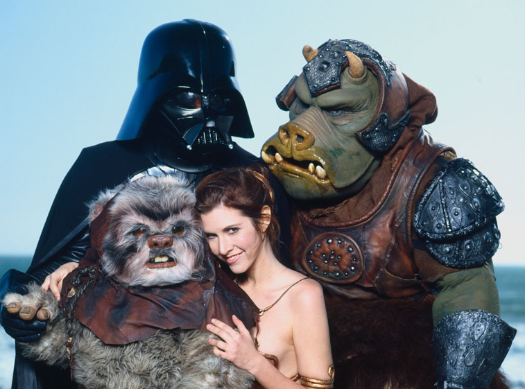 Carrie Fisher and cast of 'Star Wars' with Ewok