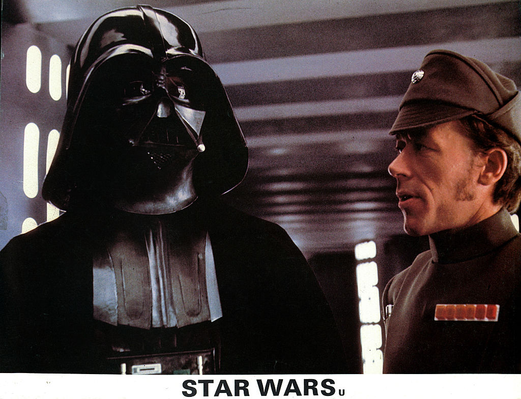 David Prowse as Darth Vader in a scene from the film 'Star Wars: A New Hope' in 1977.