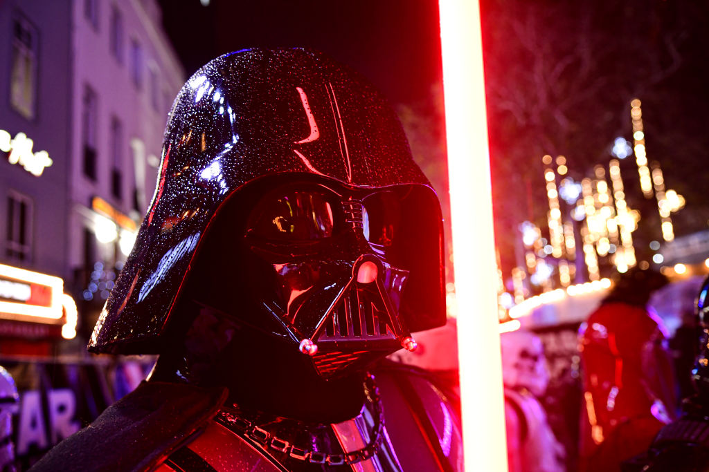 Darth Vader with his red lightsaber at the 'Star Wars: The Rise of Skywalker' Premiere in London.