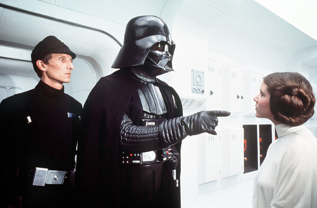 David Prowse and Carrie Fisher on the set of 'Star Wars: Episode IV - A New Hope.'