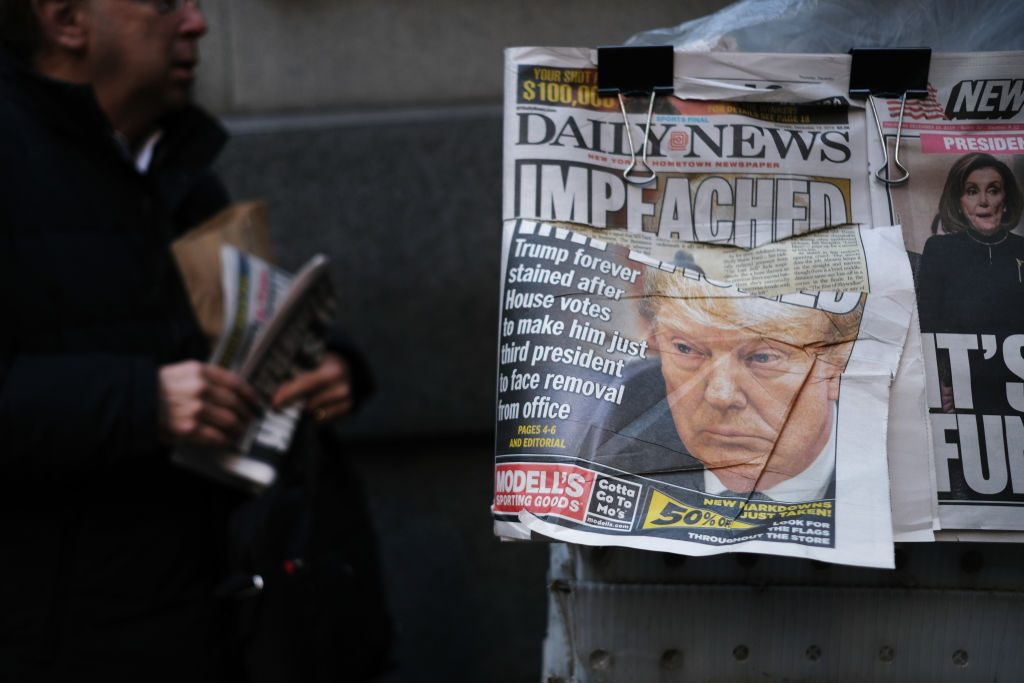 A newspaper front page shows a picture of U.S. President Donald Trump the morning after he was impeached
