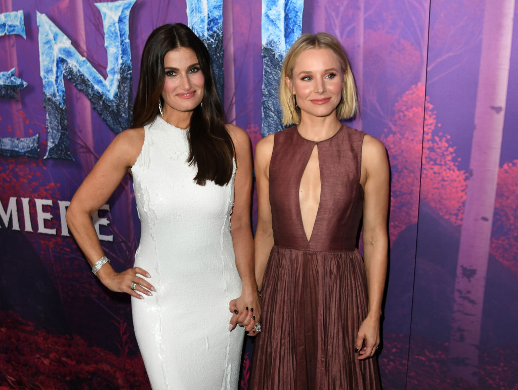 Idina Menzel and Kristen Bell hold hands on the red carpet for the premiere for 'Frozen 2.'