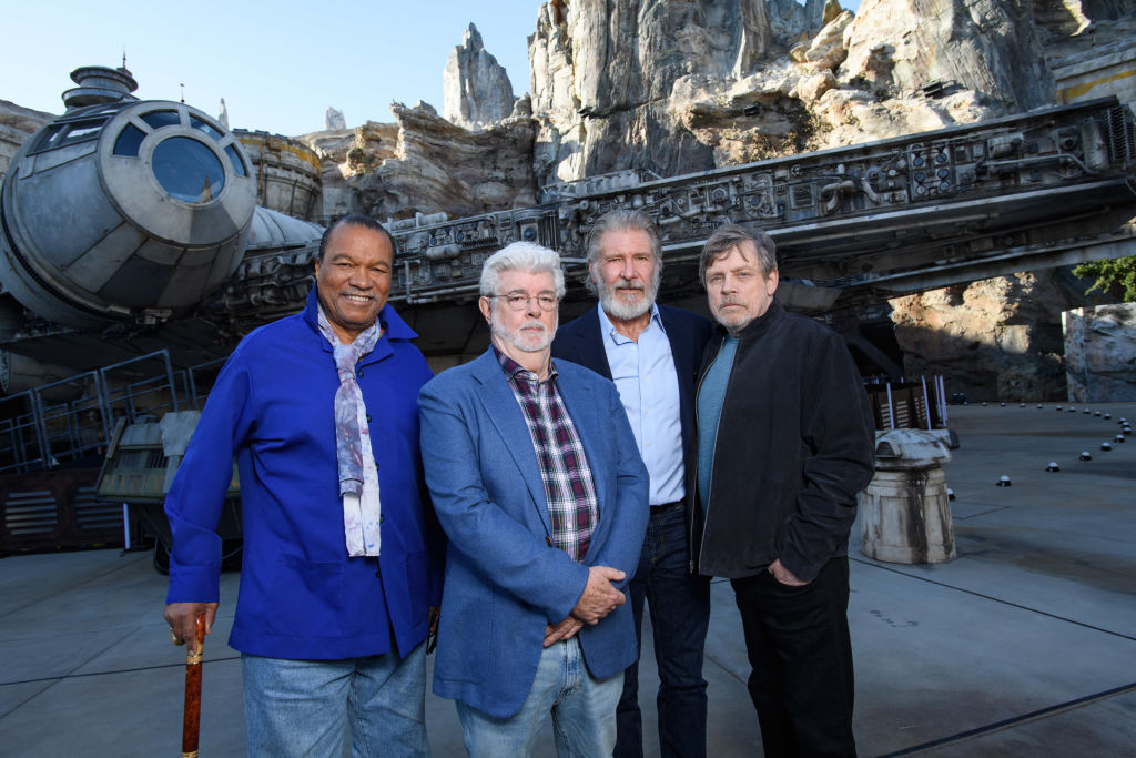 Billy Dee Williams, George Lucas, Harrison Ford, and Mark Hamill at the pre-opening launch of Star Wars: Galaxy's Edge at Disneyland.