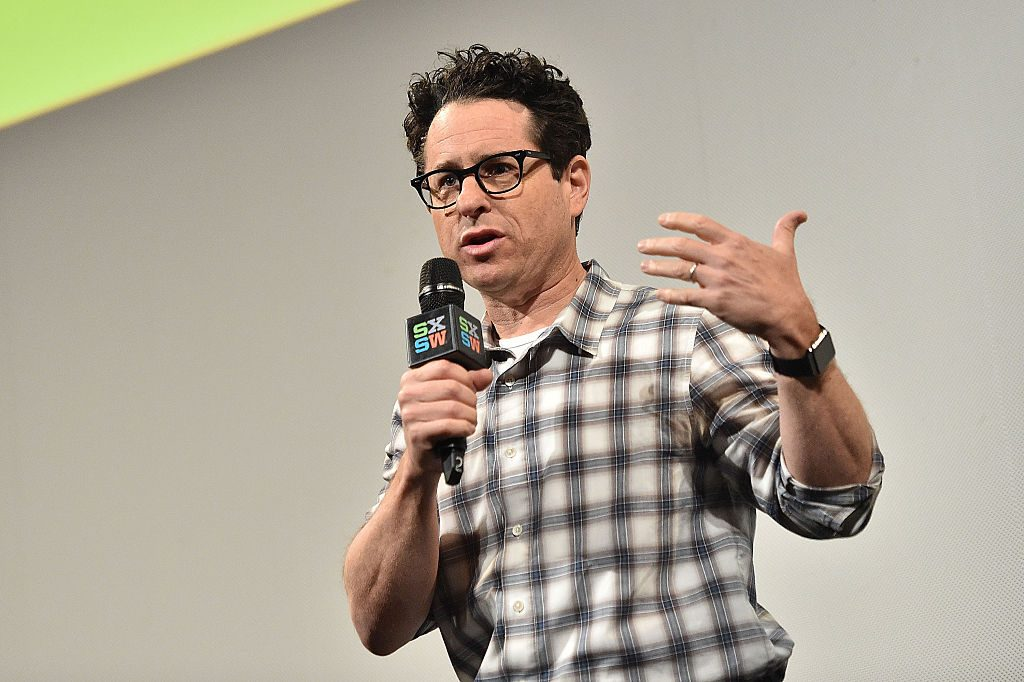 J.J. Abrams speaking into a microphone