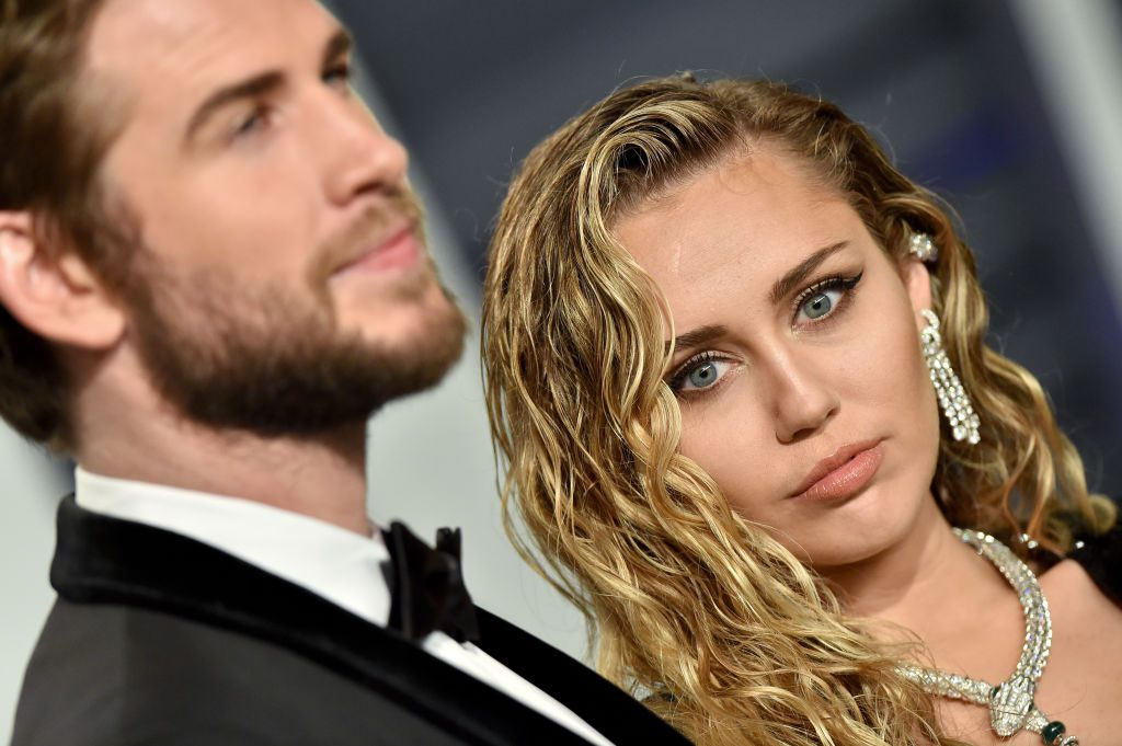 Miley Cyrus and Liam Hemsworth attend the 2019 Vanity Fair Oscar Party.