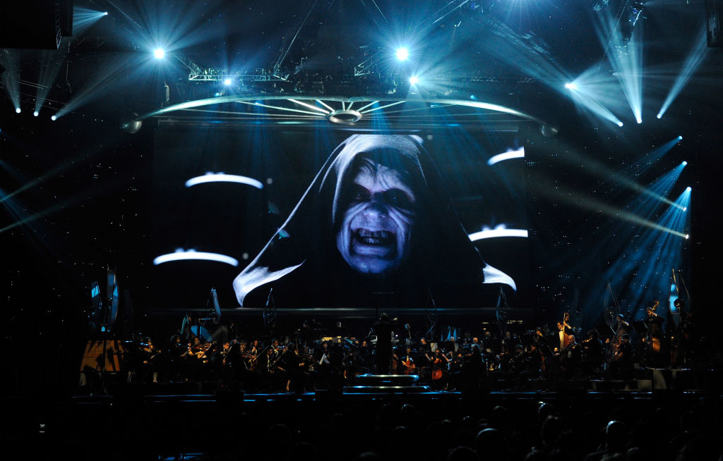 "Ian McDiarmid's Emperor Palpatine is shown on screen during ""Star Wars: In Concert"""