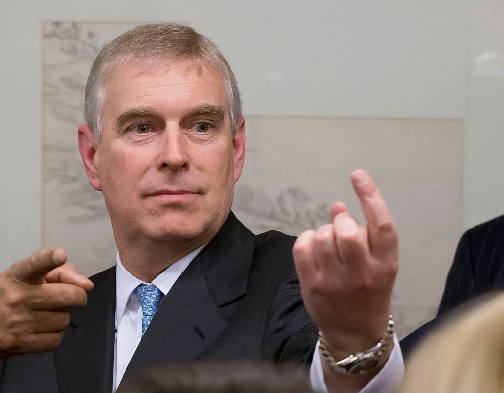 Prince Andrew, Duke of York gestures as he speaks with business leaders during a reception with business leaders.