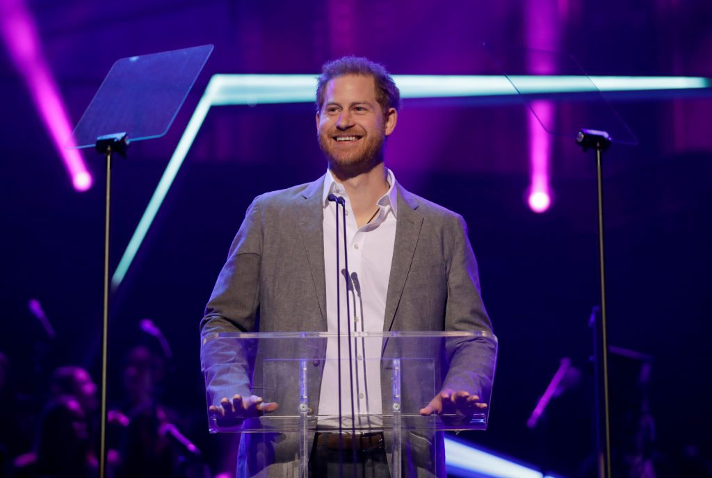 Prince Harry gives a speech on stage before announcing the winners of the Health and Wellbeing category at the inaugural OnSide Awards.