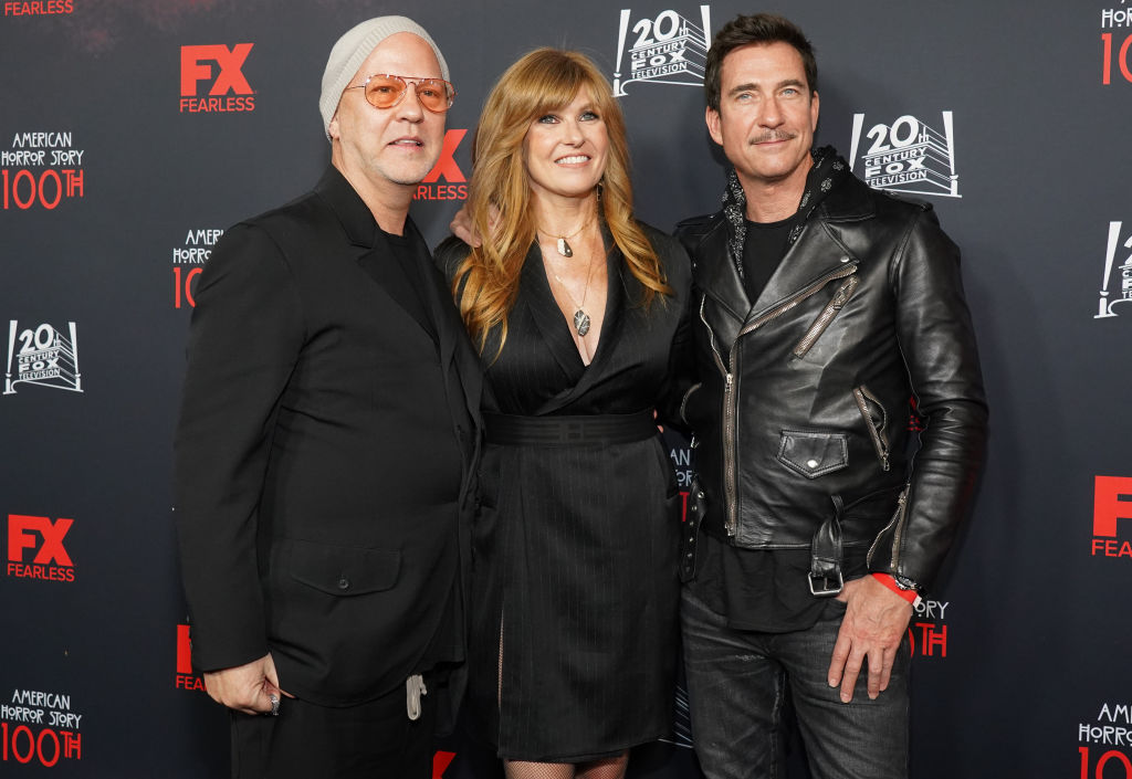 Ryan Murphy, Connie Britton, and Dylan McDermott pose on the red carpet of FX's 'American Horror Story' 100th Episode Celebration, 2019.