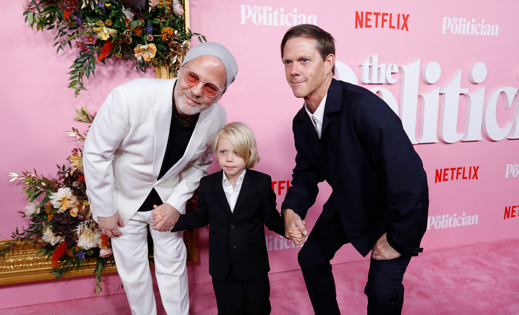 Ryan Murphy, with his son Logan Miller and his husband David Miller pose on the pink carpet at 'The Politician' New York Premiere in New York City.