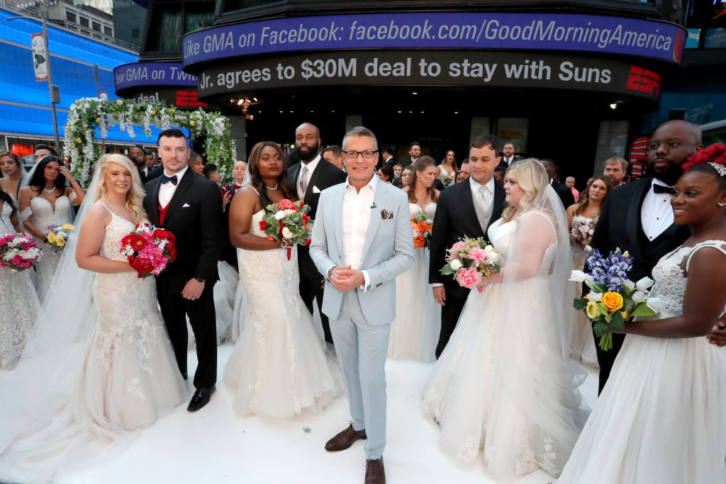 Randy Fenoli with brides and grooms