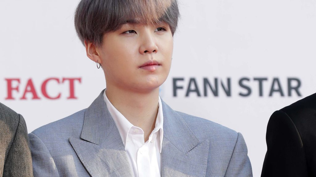 Suga of boy band BTS attends the photocall for U Plus 5G 'The Fact Music Awards' on April 24, 2019