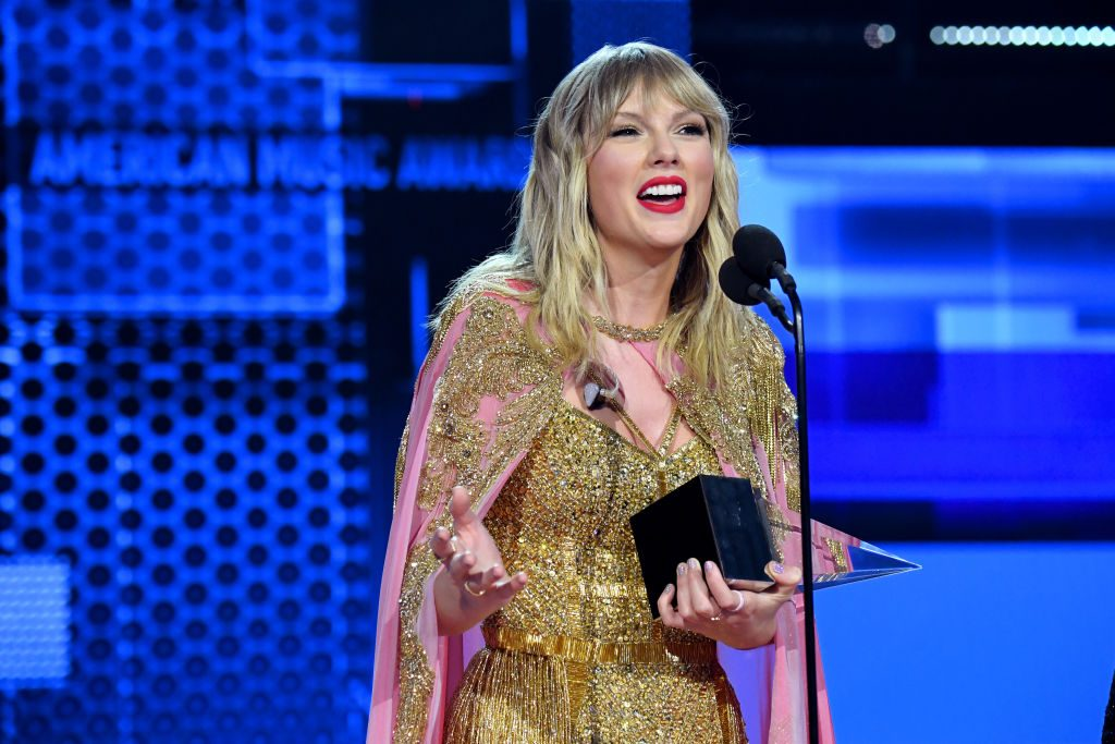 Taylor Swift accepts the Artist of the Decade award at the American Music Awards on Nov. 24, 2019
