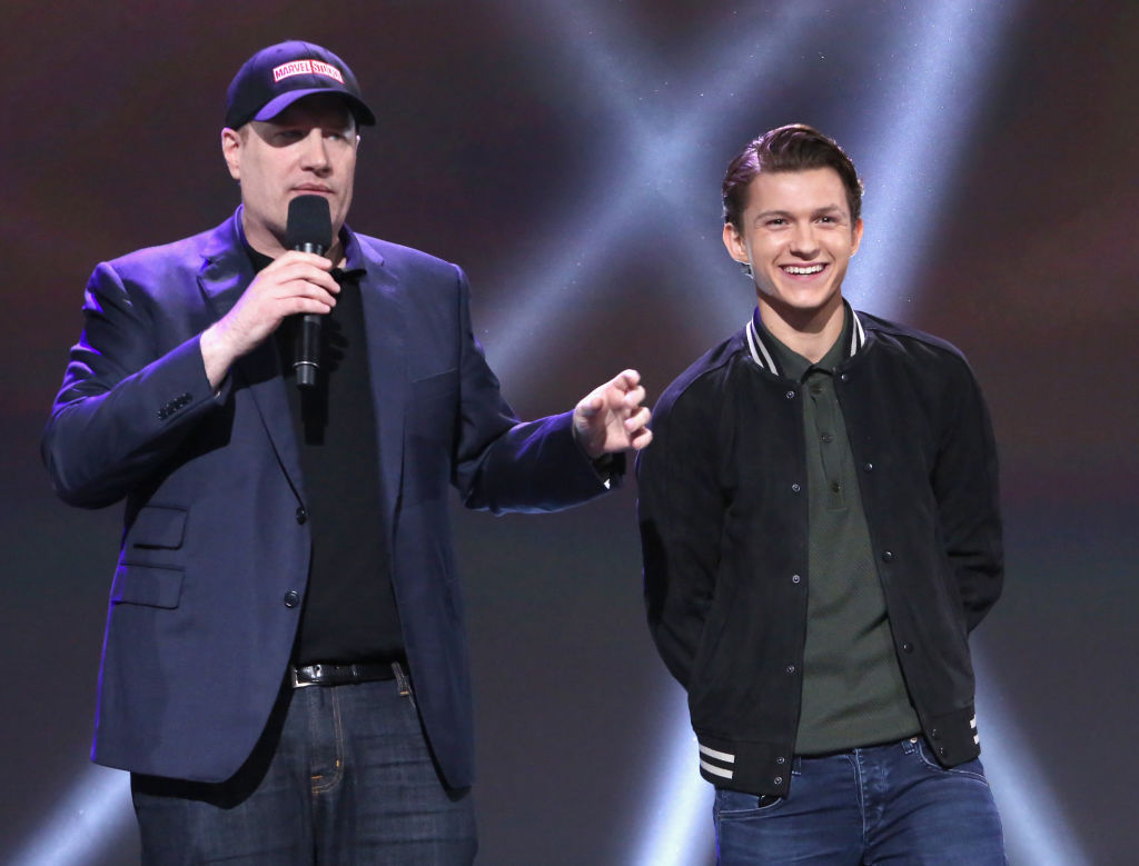 Kevin Feige and Tom Holland present at Disney's D23 Expo in 2017.