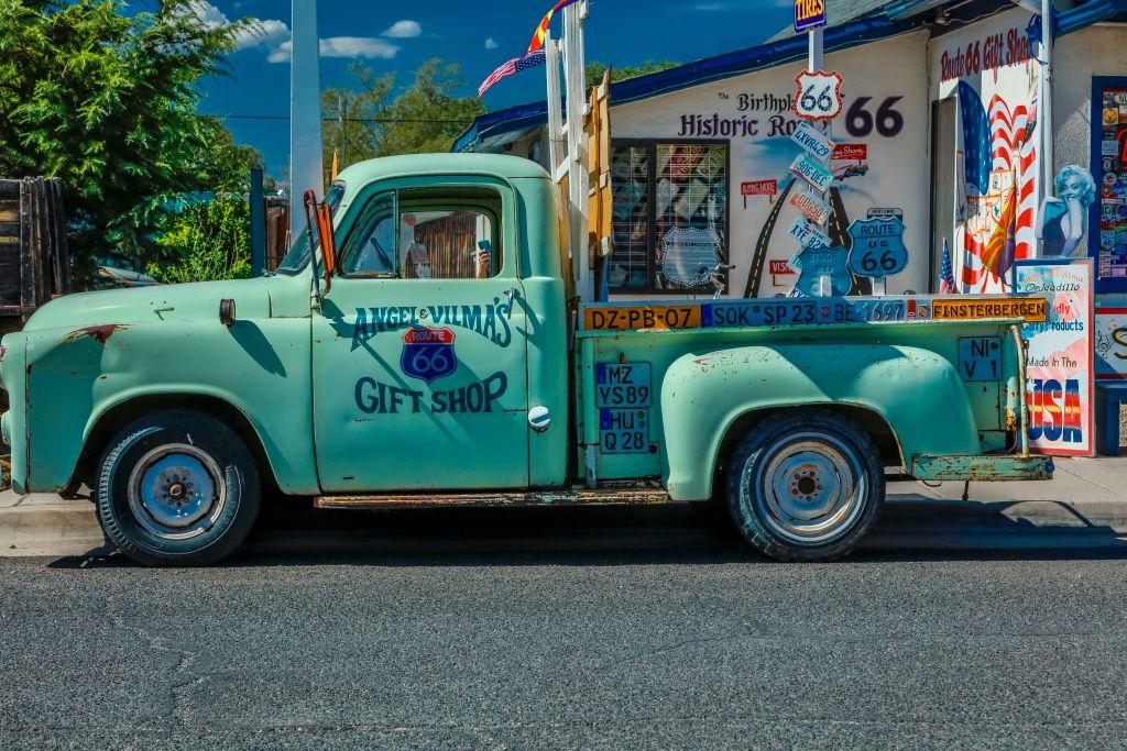 Green pickup truck on Main Street, Seligman on historic Route 66, Arizona.