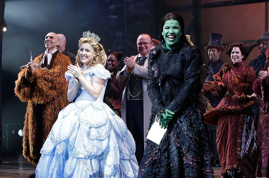 Alli Mauzey and Lindsay Mendez, in the roles of Galinda and Elphaba, at the curtain call for 'Wicked' Celebrates 10th Anniversary On Broadway in 2013.