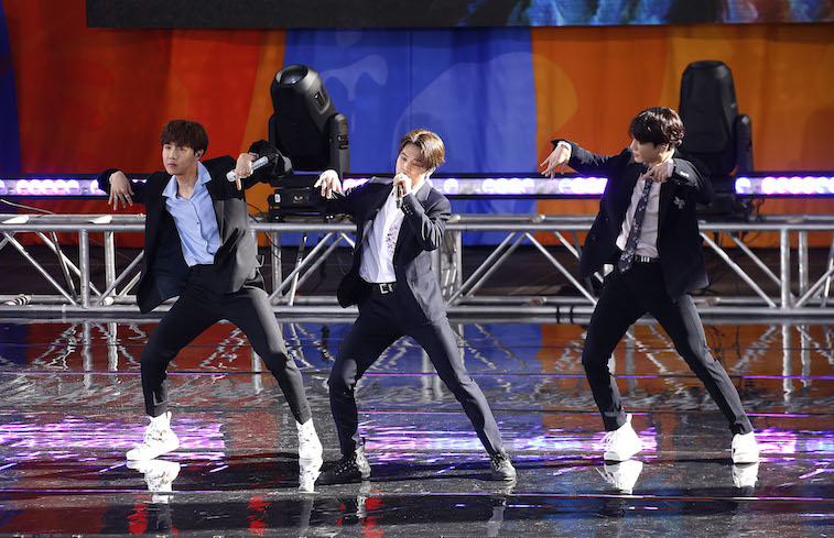 The members of BTS perform onstage