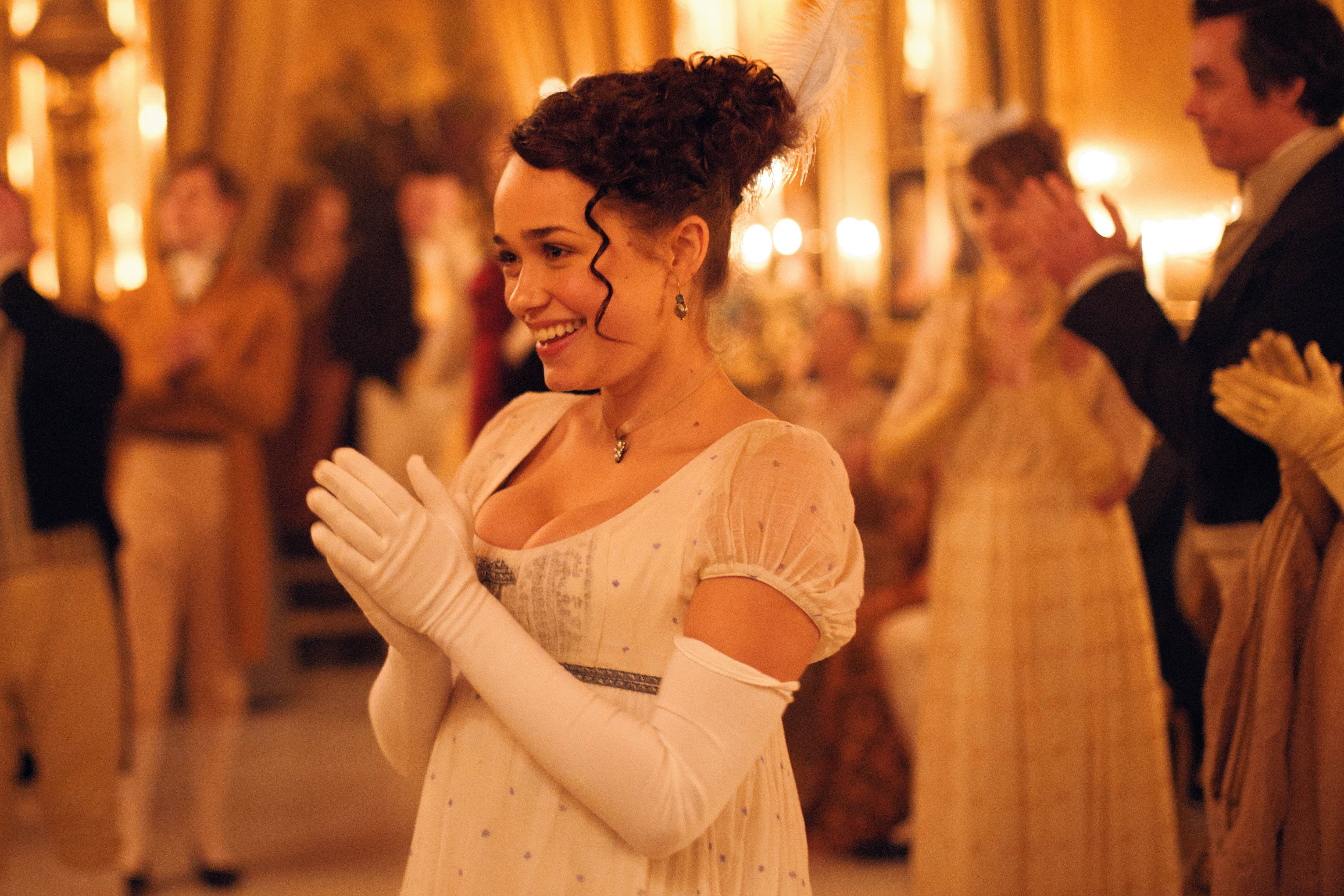 Rose Wiliams as Charlotte Heywood at a ball and clapping in 'Sanditon'