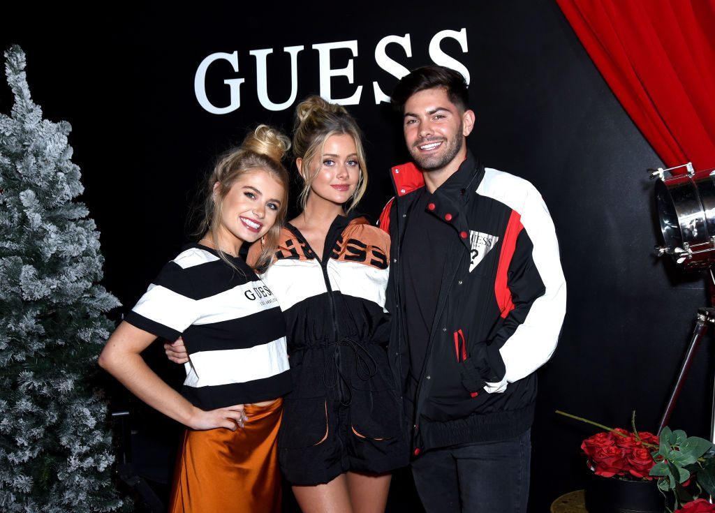 Demi Burnett, Hannah Godwin, and Dylan Barbour attend GUESS Kicks-off Holiday Season at The Peppermint Club on Nov. 07, 2019