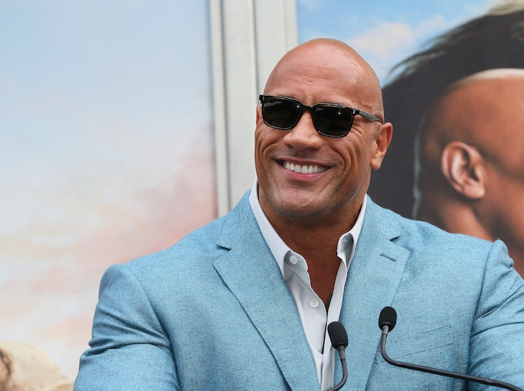 Dwayne Johnson speaks at an awards ceremony