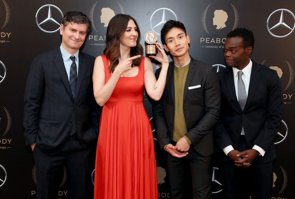 Michael Schur, D'Arcy Carden, Manny Jacinto, and William Jackson Harper pose with the Peabody Award for The Good Place.