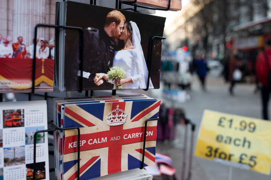 Harry and Meghan postcards for sale next to a Union Jack flag card with the slogan 'Keep Calm And Carry On'
