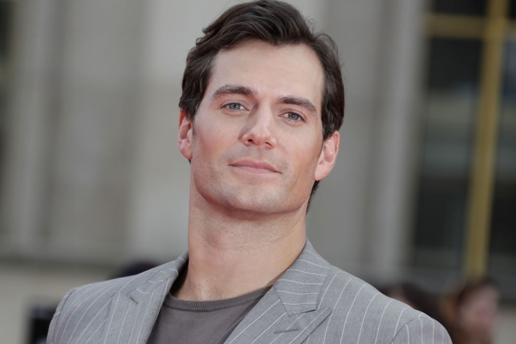 Henry Cavill poses on the red carpet.