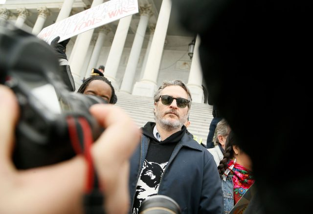 Joaquin Phoenix stands with protestors on the steps of the U.S. Capitol Building