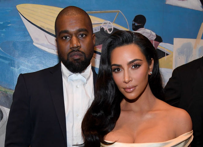 Kanye West and Kim Kardashian West at a party in December 2019