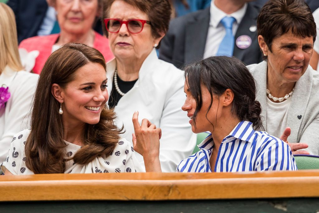 The Duchess of Cambridge and the Duchess of Sussex attend day twelve match of the 2018 Wimbledon