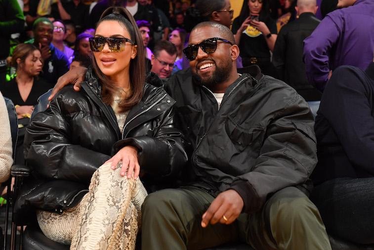 Kim Kardashian and Kanye West attend a basketball game