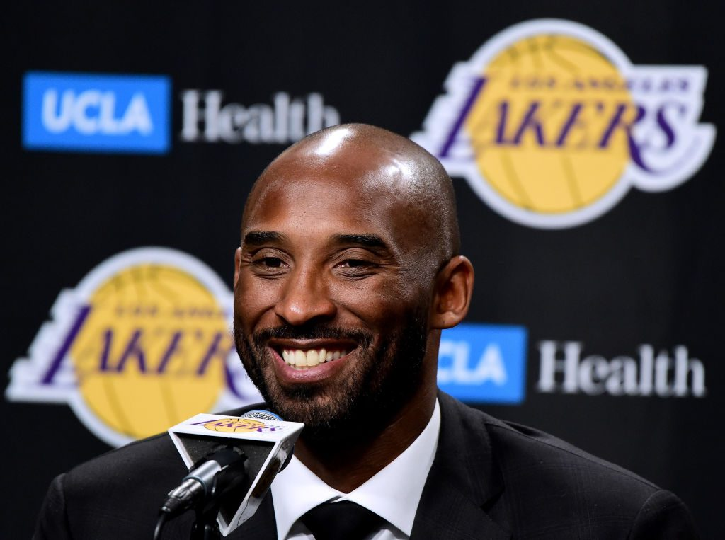 Kobe Bryant speaks to the media at a press conference.