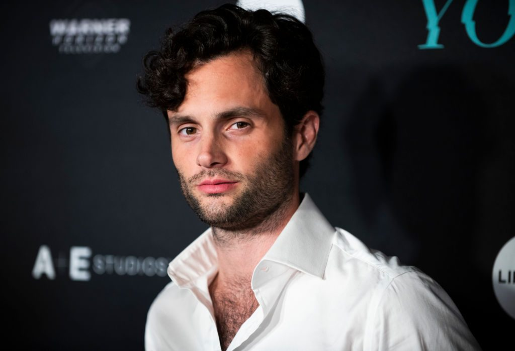 "Penn Badgley in front of repeating background for Netflix's ""You"""