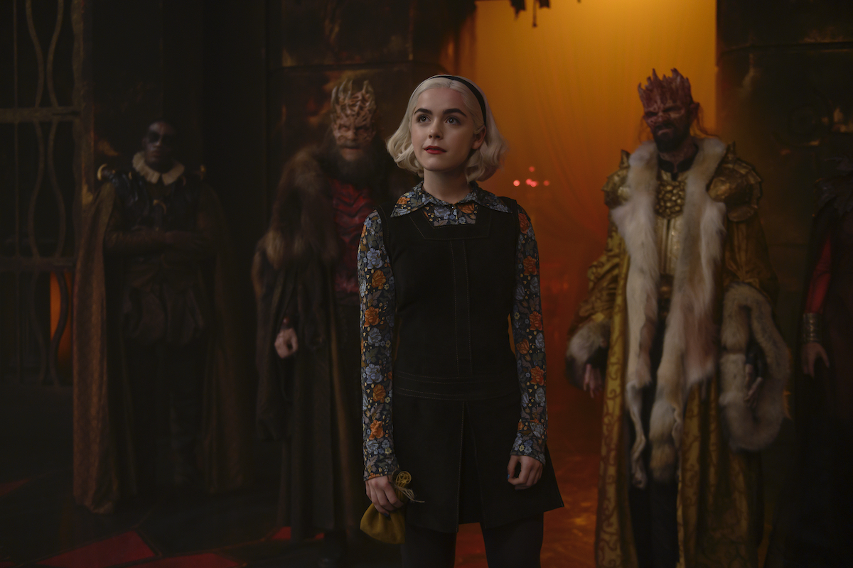 Sabrina Spellman in front of the kings of Hell, 'CHILLING ADVENTURES OF SABRINA.'