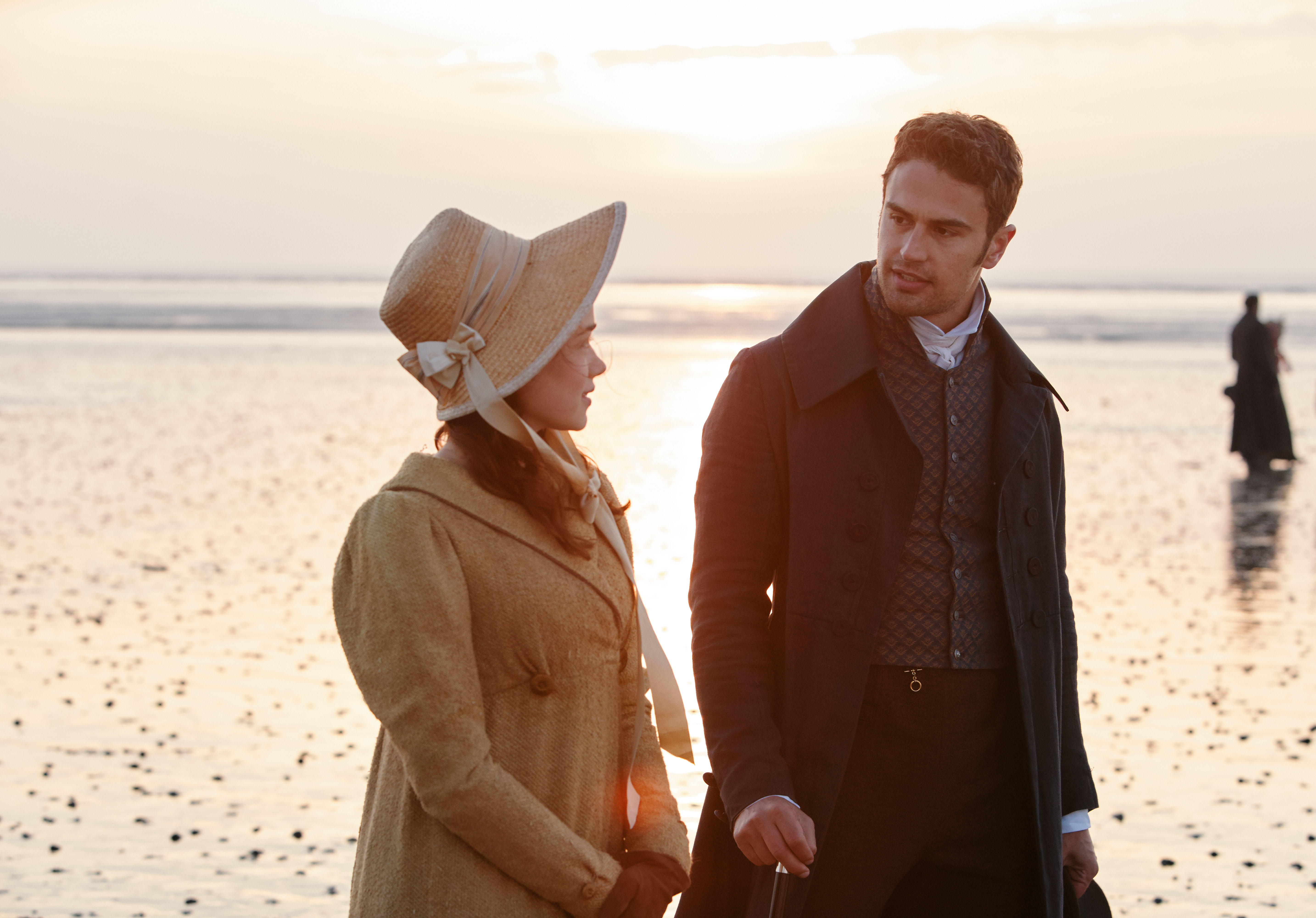 Charlotte and Sidney walking on the beach in 'Sanditon'