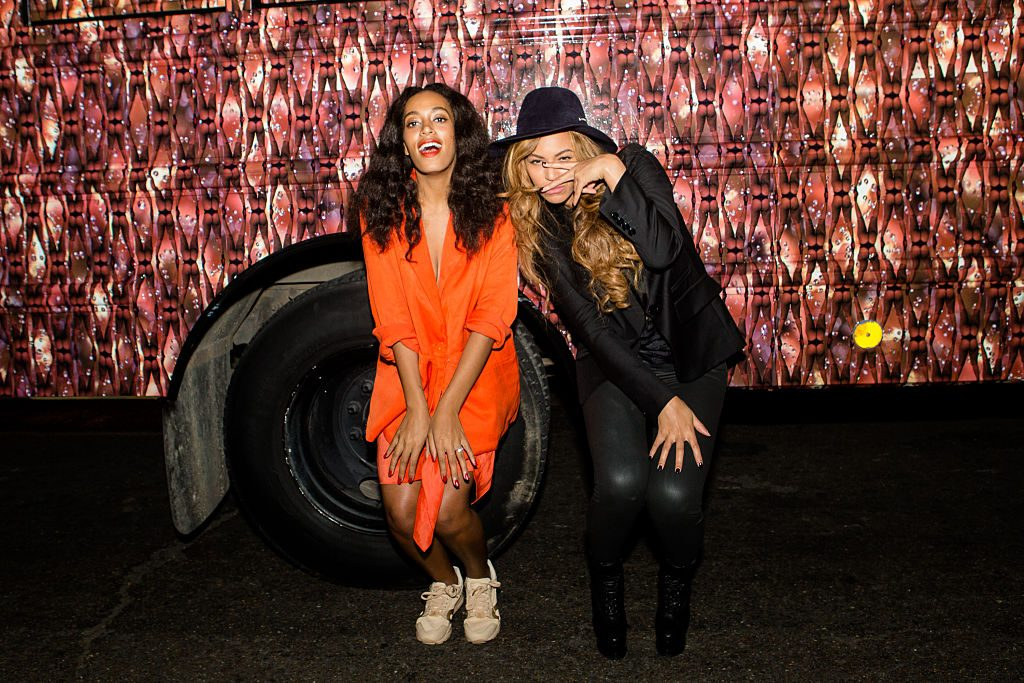 Solange Knowles and Beyonce Knowles at an event in 2014